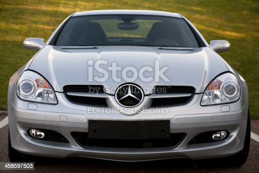 Aalen, Germany  - June 16, 2007: Front view of a Mercedes-Benz SLK Class at a car dealership, the SLK is the compact roadster, one of the first modern retractable hardtop convertibles, it's built in Bremen, Germany.