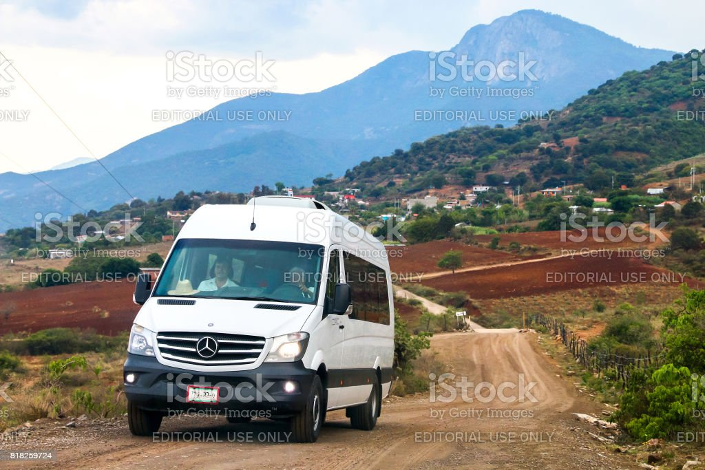 Mercedes-Benz Sprinter OAXACA, MEXICO - MAY 26, 2017: Passenger van Mercedes-Benz Sprinter at the countryside. Bus Stock Photo