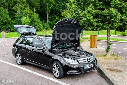 Rhone-Alpes, France - August 7, 2014: Motor car Mercedes-Benz W204 C180 is parked at the parking near the interurban freeway.