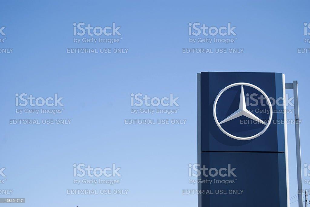 Mercedez-Benz Dealership Sign Against Clear Sky stock photo