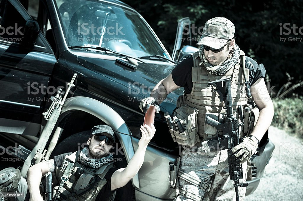 Mercenary Contractor Soldiers Drinking at Roadblock Checkpoint royalty-free stock photo