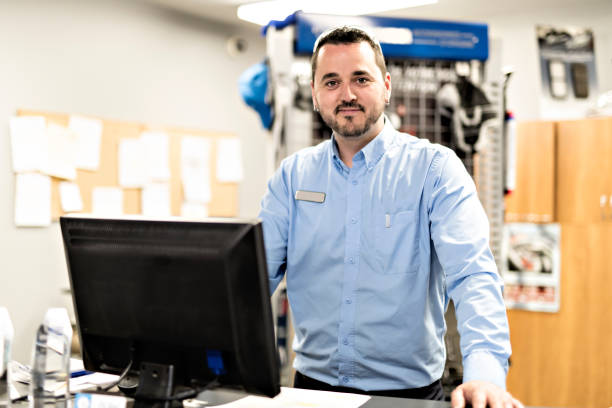 merchandiser checking products availibility for car repair A Mechanics with merchandiser checking products availibility seller stock pictures, royalty-free photos & images