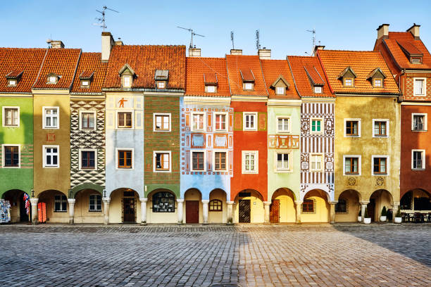 merchant houses in the poznan old market square, poland. - poland stock photos and pictures
