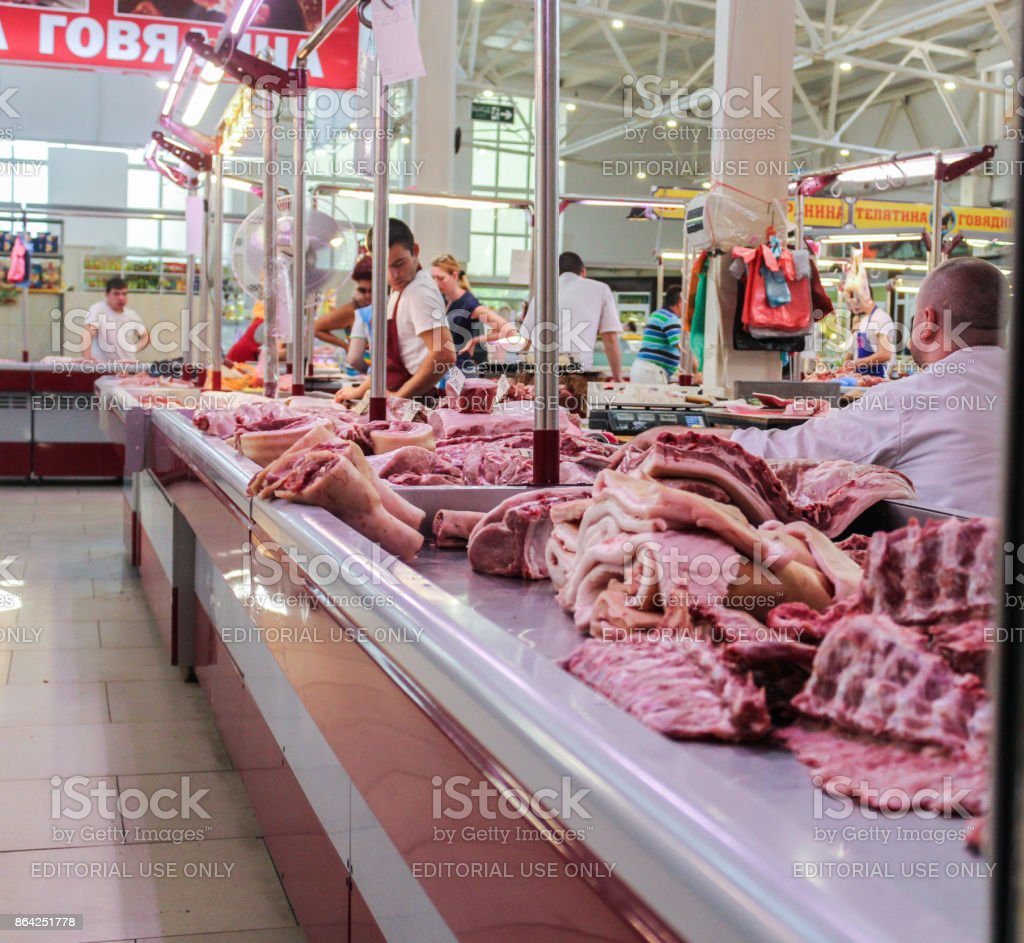 Merchants behind the counter with meat. royalty-free stock photo