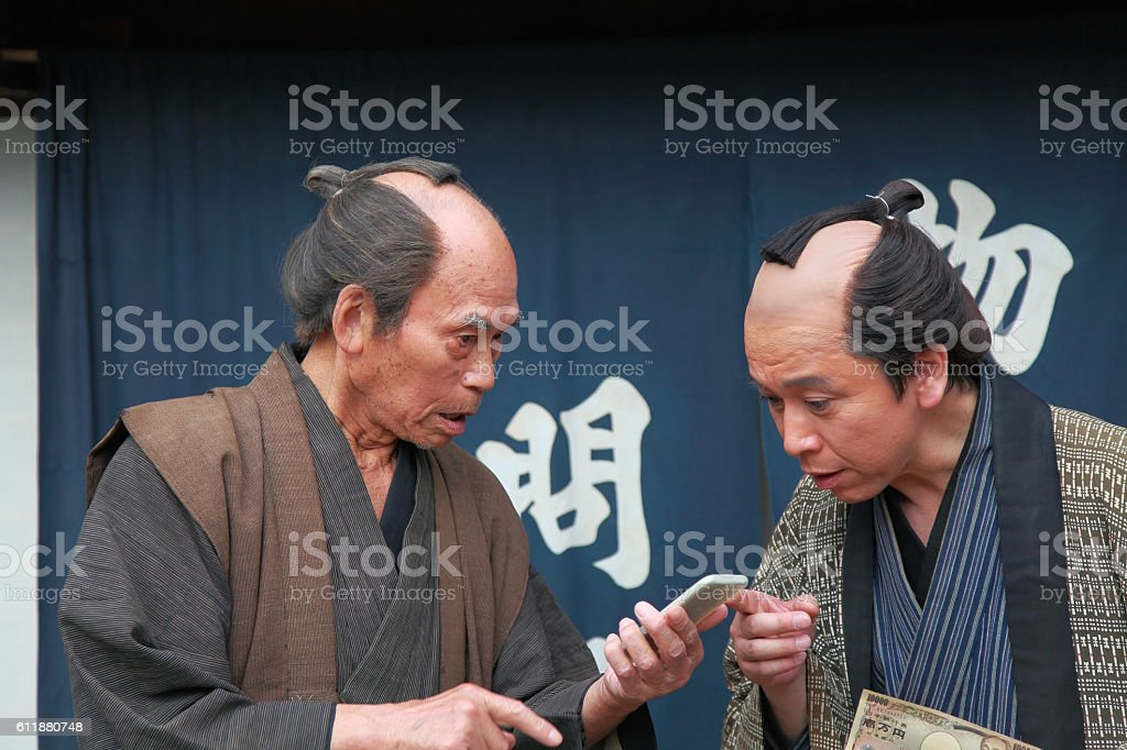 merchants with smart phone and cash money stock photo