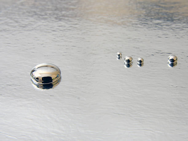 mercury - quicksilver droplets  mercury metal stock pictures, royalty-free photos & images
