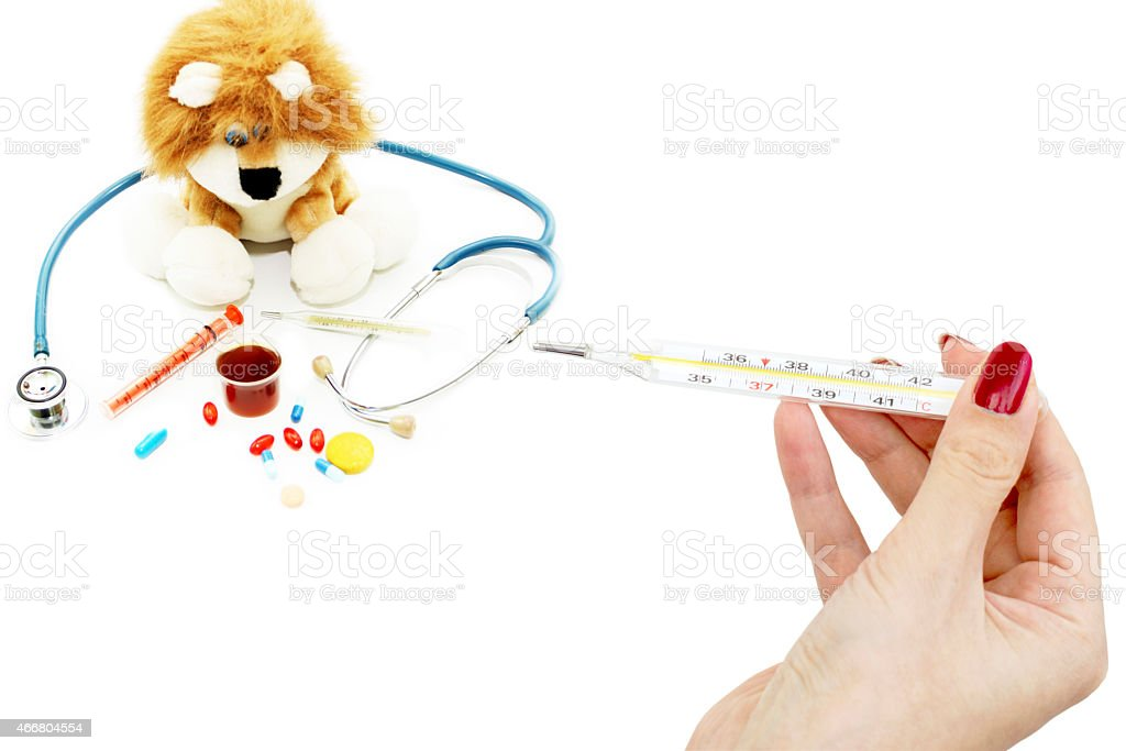 Mercury thermometer in her hands and toy with the stethoscope stock photo