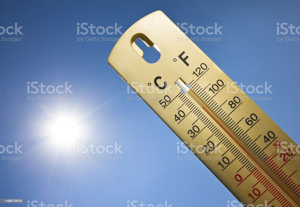 Mercury thermometer marking 38 degrees Celsius in sunny day stock photo