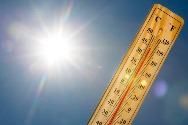 Mercury thermometer Summer heat Sun light stock photo
