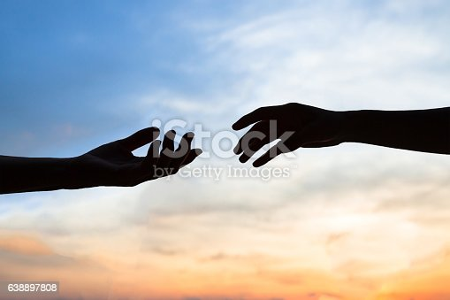 istock mercy, two hands silhouette, help concept 638897808