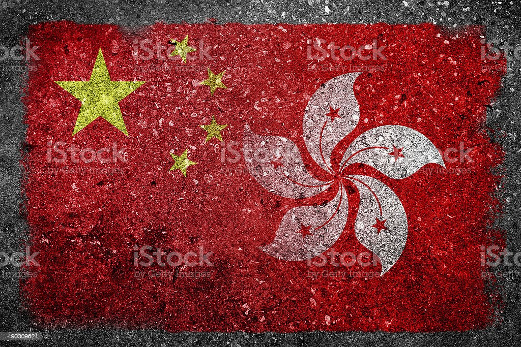 Merged Flags of China and Hong Kong Painted on Concrete stock photo