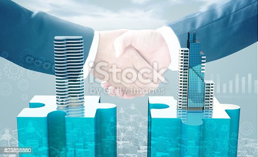 470163746 istock photo merger and acquisition business concepts, join puzzle pieces 823858880