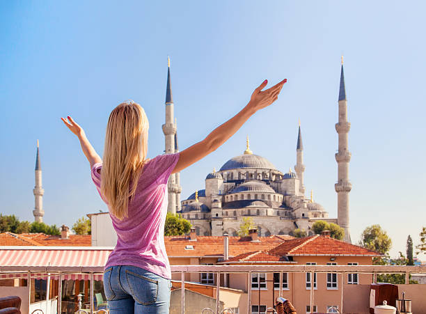 Merhaba, Istanbul! Girl welcomes the Blue mosque in Istanbul. stock photo