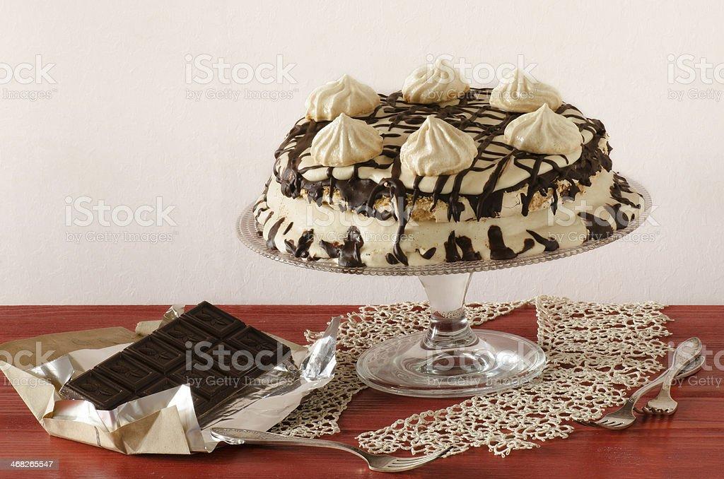 Meringue cake with mascarpone cream and chocolate stock photo