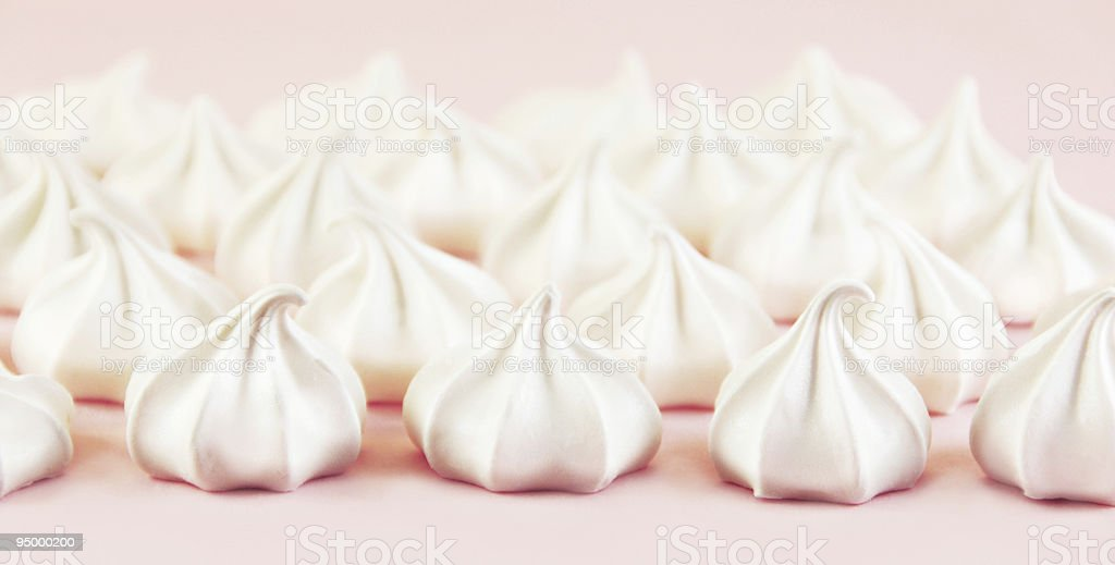 Meringue Cookies with Pink Background stock photo