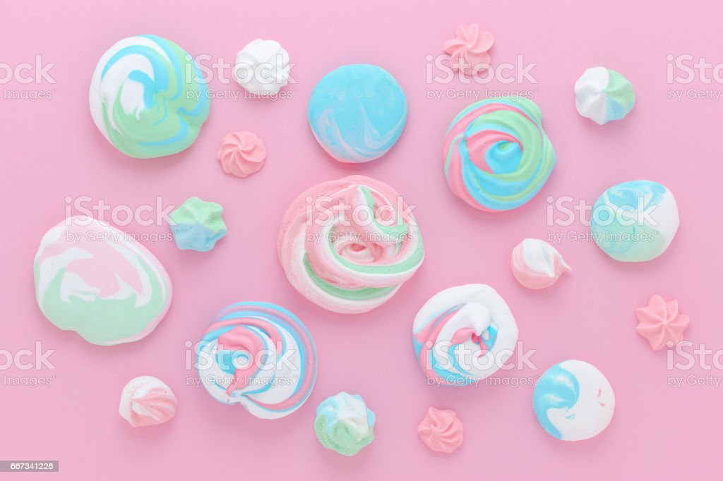 meringues in pastel colors, pattern abstract on pink background stock photo