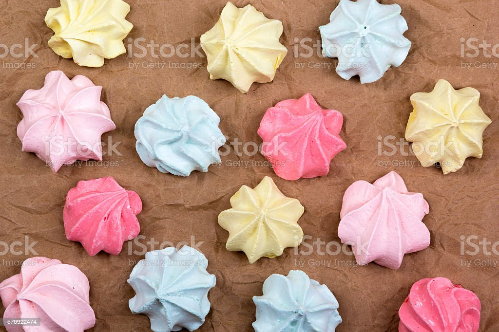 Meringues on crumpled paper top view stock photo