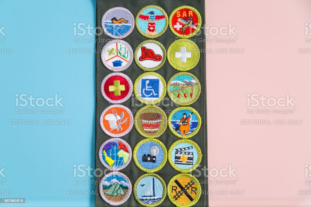 Merit Badge Sash on Blue and Pink stock photo