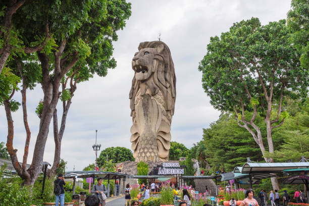 Merlion at Sentosa island The 37 metres tall merlion sculpture is a landmark of Sentosa Island in Singapore. merlion fictional character stock pictures, royalty-free photos & images