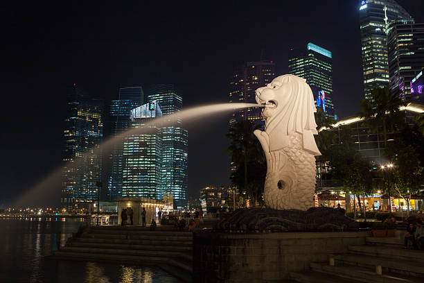 "Merlion Park in Singapore ""Singapore City, Singapore - May 16, 2012 : People at Merlion Park. Merilon Statue at Marina Bay with Singapore skyline. Merlion is a famous icon of Singapore."" merlion fictional character stock pictures, royalty-free photos & images"