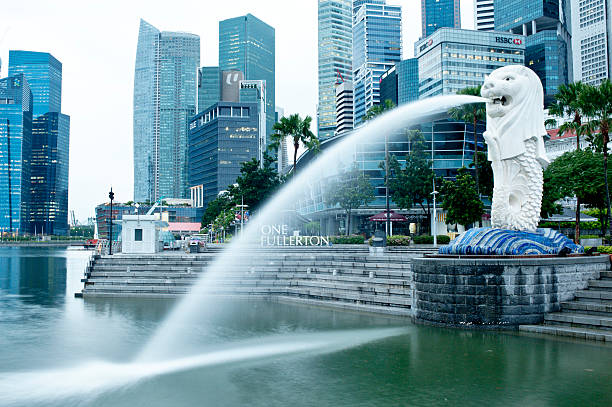 Merlion Park, Singapore Singapore City, Singapore - October 4th, 2011: Merlion park is in the central business district of Singapore. It is a popular tourist attraction over looking the Marina Bay towrds the Sand Htel and the ArtScience Museum. merlion fictional character stock pictures, royalty-free photos & images