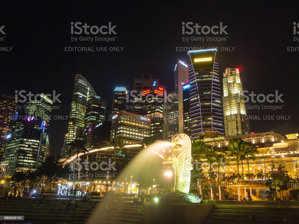 Merlion statue fountain and city skyline at night in singapore stock photo
