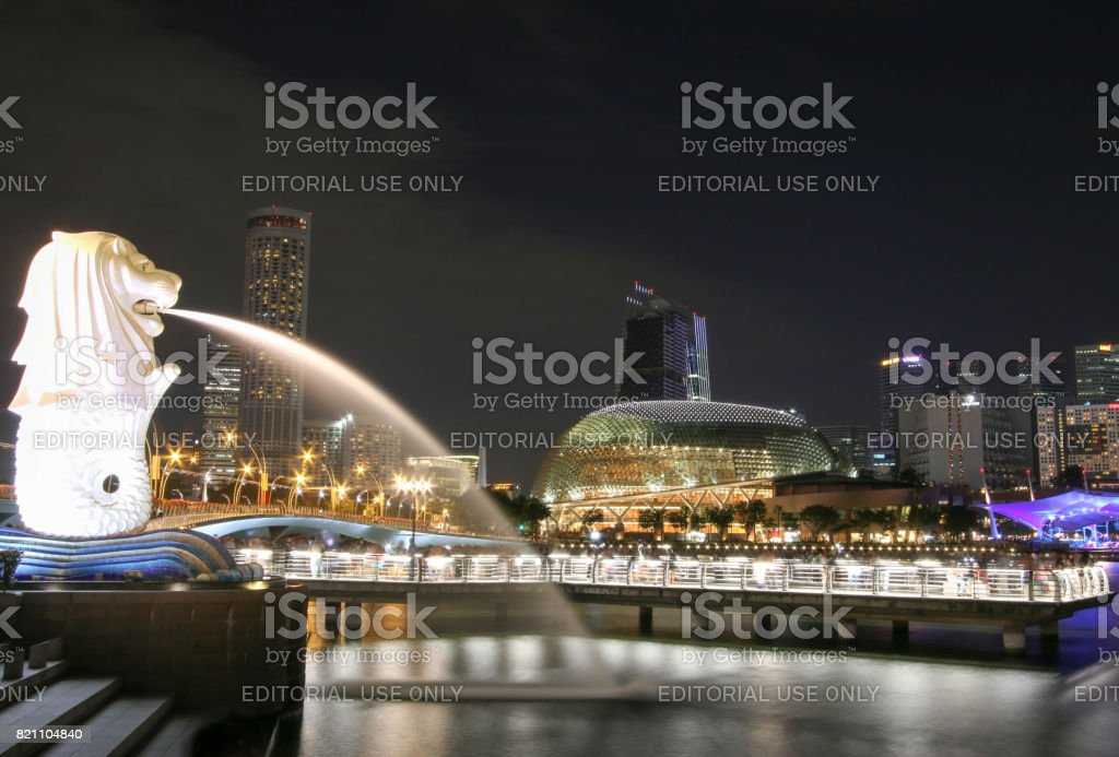 Singapore - JULY 7, 2017 : Merlion statue fountain in Merlion Park and Singapore city skyline at night. stock photo