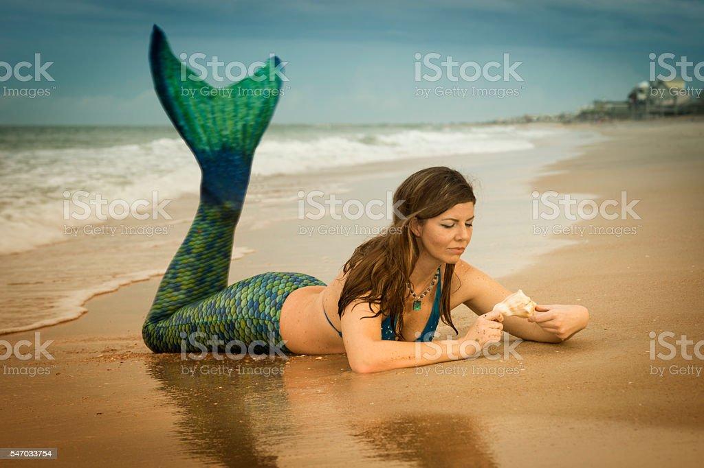Mermaid at sunset stock photo