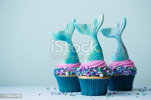 Mermaid cupcakes on a blue background