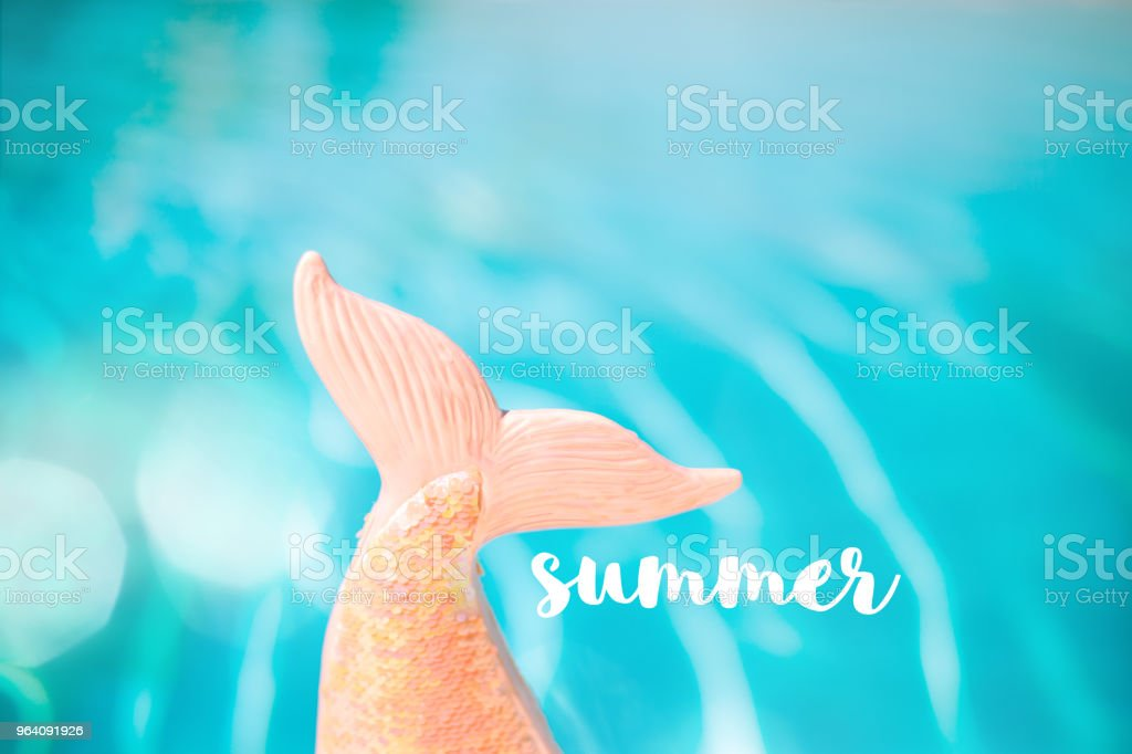 Mermaid sequin tail with turquois pool water in background - Royalty-free Albania Stock Photo