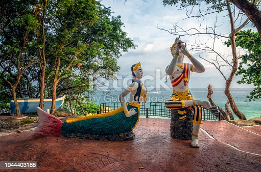 Mermaid statue and children at Sai Kaew beach in Samed island, Rayong Province, Thailand on 18 October 2015.