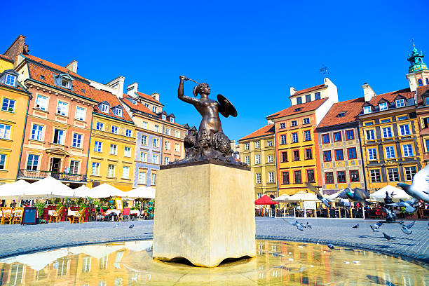 mermaid statue in warsaw old town - poland stock photos and pictures