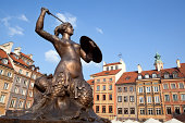 """""""Warsaw's mermaid statue located in the center of Old Town square. Warsaw's Old Town Market Place is the center and oldest part of the Old Town of Warsaw, capital of Poland. Immediately after the Warsaw Uprising, it was systematically blown up by the German Army."""""""