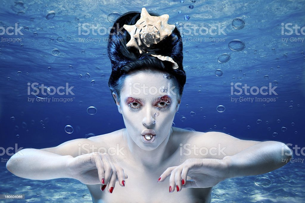mermaid under water with a pearl royalty-free stock photo
