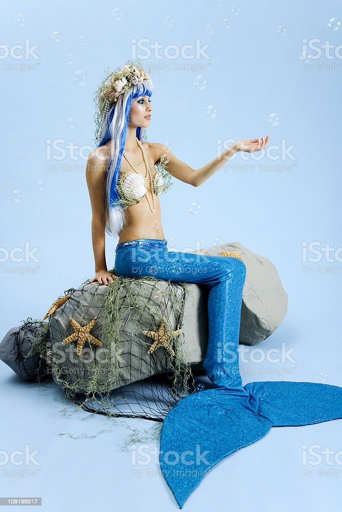 Mermaid with Falling Bubbles stock photo