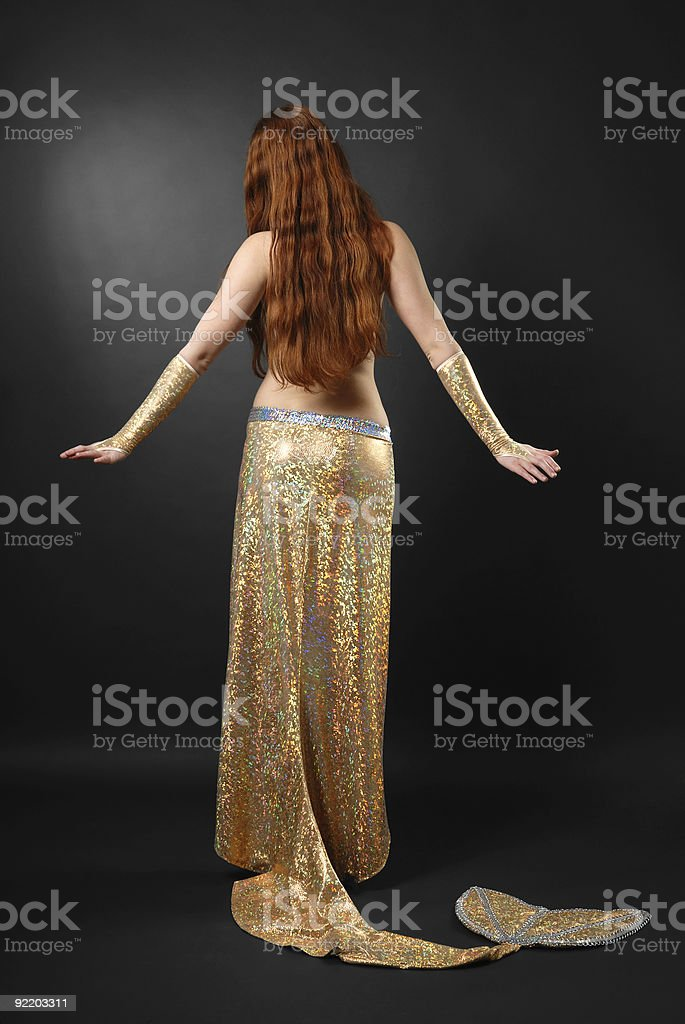 Mermaid with long red hair, rear view stock photo