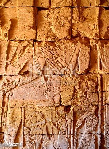 Meroe, Begarawiyah, Kush, Sudan: Nubian pyramids of Meroe, tombs of the Kushite kingdoms - Archaeological Sites of the Island of Meroe - UNESCO World Heritage Site - dated c. 800 BCE – c. 350 CE -  pyramid N12, Kandake Shanakdakhete - bas relief if god, North Necropolis