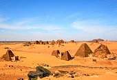 Meroe pyramids, South and North cemeteries (foreground and background) - Nubian tombs in the Sahara desert - UNESCO World Heritage Site, Begarawiyah, Sudan