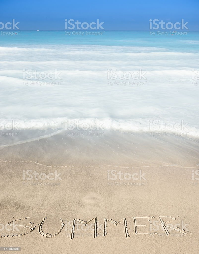 Merry christams message on the sand beach royalty-free stock photo
