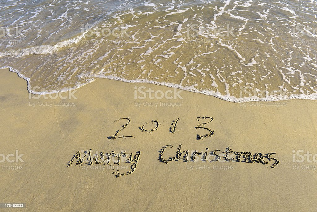 merry christmas 2013 message on the sand beach royalty-free stock photo