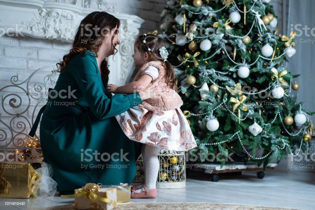 Merry Christmas and happy holidays. Beautiful mother and daughter...