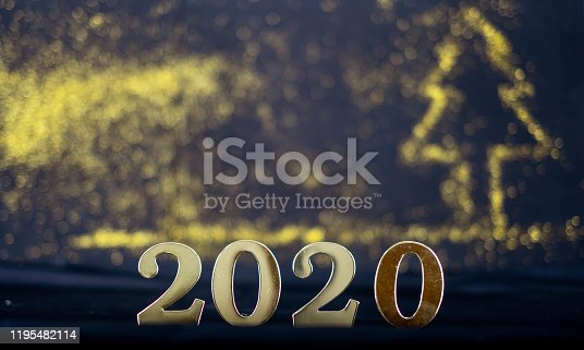 1049836902 istock photo merry christmas and Happy New Year 2020 - New Year Shining background with gold and glitter bokeh.2020 new year card.Holiday concept 1195482114