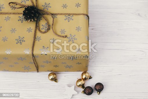 Merry Christmas And Happy New Year Concept Stylish Wrapped Gift Box With Ornaments And Golden Pine Cone Space For Text Seasonal Greetings Happy Holidays Xmas Present Stock Photo & More Pictures of Above