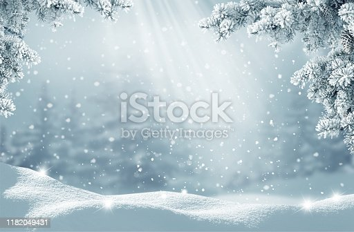 istock Merry Christmas and happy new year greeting card. Winter landscape with snow .Christmas background with fir tree branch 1182049431
