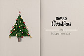 istock Merry Christmas and happy new year greetings in vertical top view cardboard with natural eco decorated christmas tree pine.Ecology concept.Xmas winter holiday season social media card background 1058888418