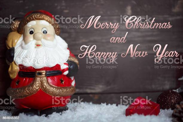 Photo of Merry Christmas and Happy New Year- Santa Claus on snow