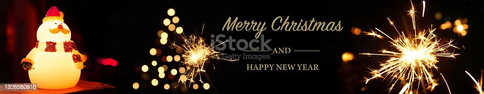 istock Merry Christmas and happy new year. Snowman toy , Christmas tree as burning sparkler flames. Silvester background web banner panorama sparkling lights firework. 1326580910