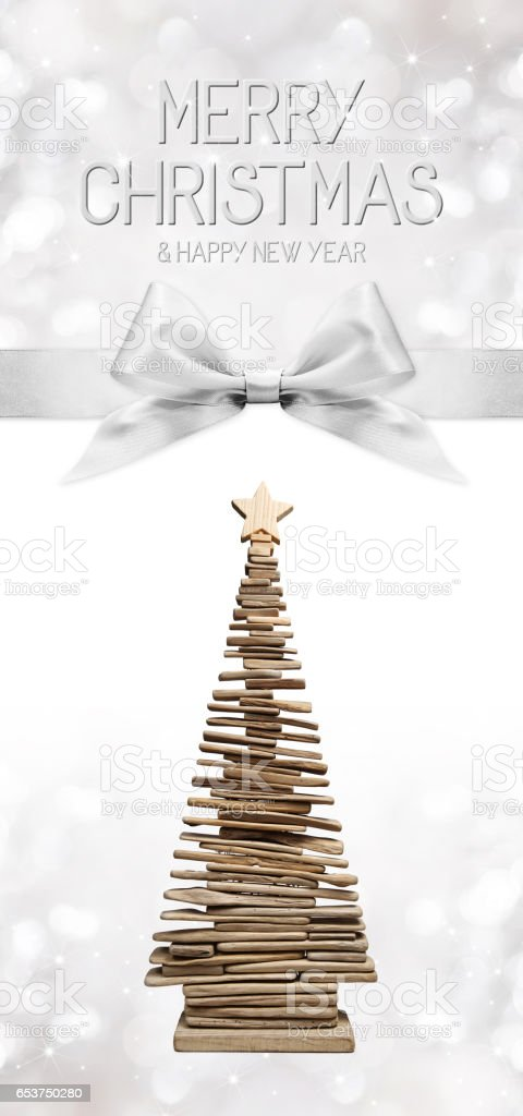 merry christmas and happy new year text with wooden tree and silver ribbon bow stock photo