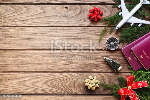 istock Merry Christmas and Happy new years travel concept background for winter trip on wood background , Travel with airplane top view with copy space. 1074112410