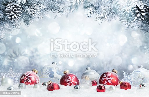istock Merry Christmas - Baubles On Snow With Fir Branches 1066685262